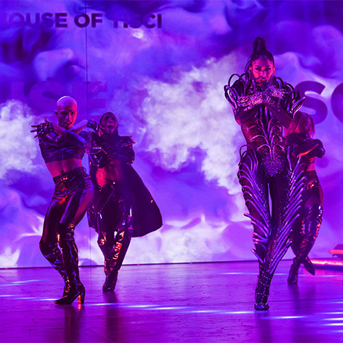 Dancers on a purple stage