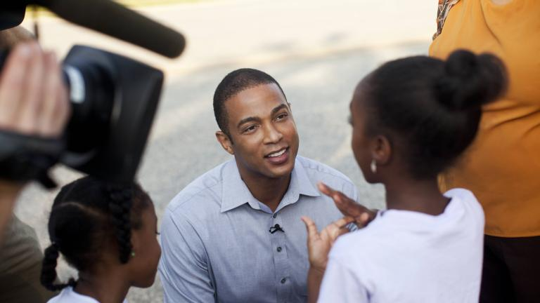 Don Lemon interacting with kids